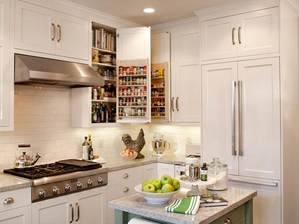 小编的话:这间厨房的面积不大,但也保留了小吧台的设计,特别的是选择了一款可移动的小吧台,全身都附带收纳功能,尤其是保鲜袋的存放让人眼前一亮。 完美厨房装修效果图八: